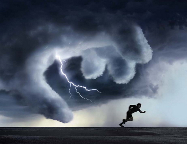 Man escaping the thunder by Steve Bronstein